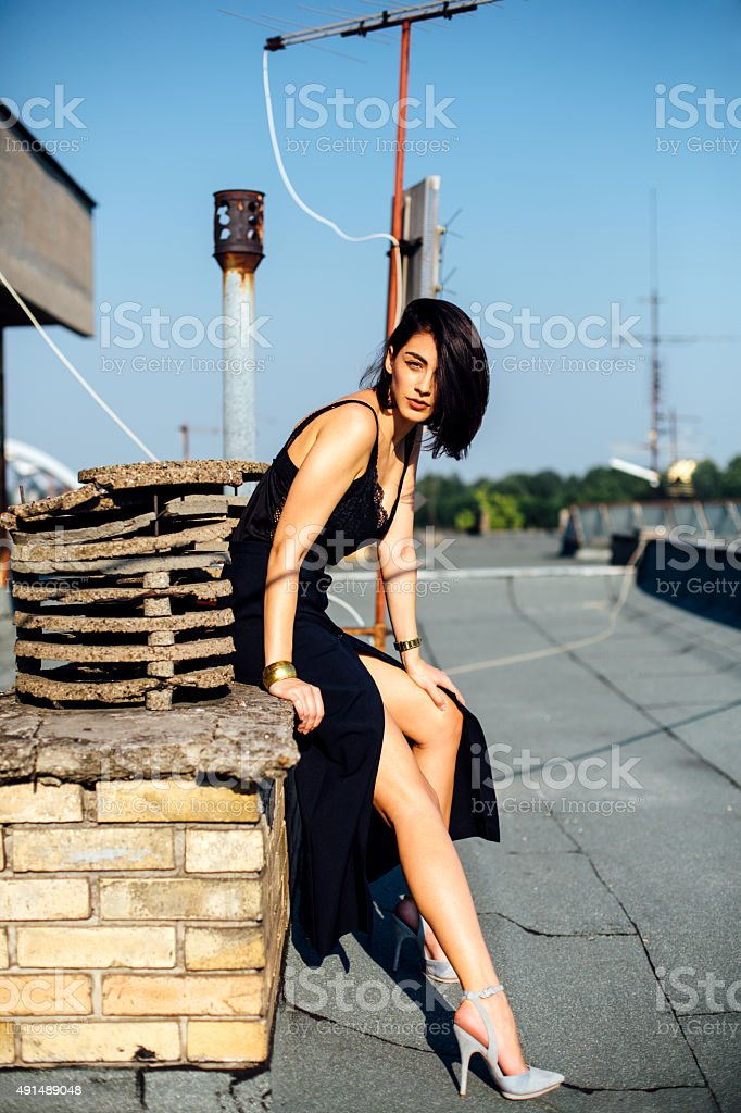 Fashion model on the roof stock photo