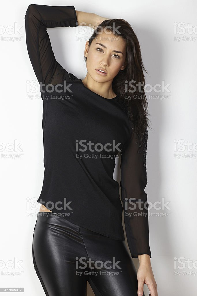 Fashion model portrait posing hand behind head royalty-free stock photo