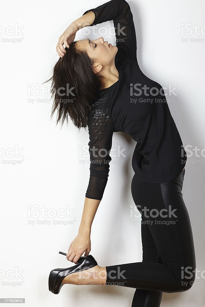 Fashion model portrait posing hand holding high heels royalty-free stock photo