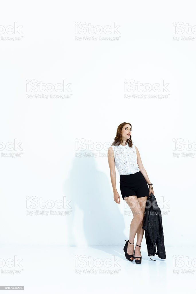 Fashion model posing in a white space royalty-free stock photo