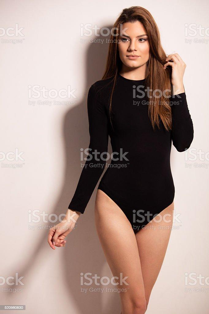 Fashion model posing in black leotard stock photo