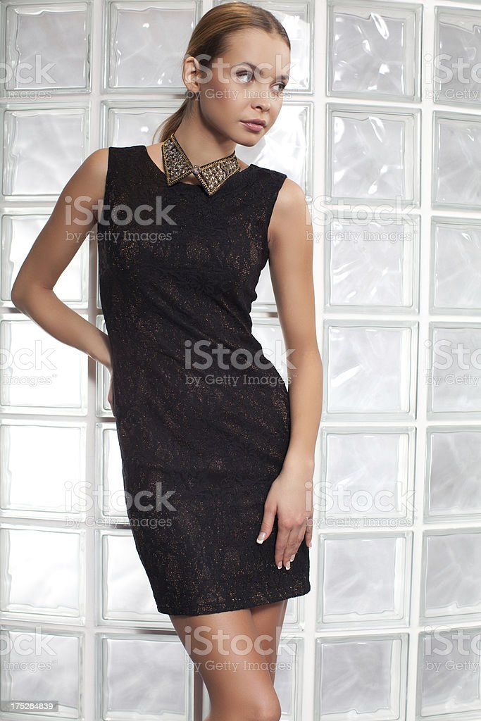Fashion model posing in elegant dress royalty-free stock photo