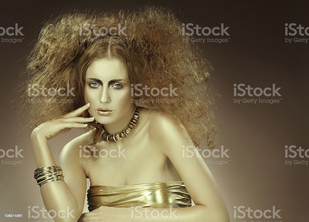 fashion model posing in gold stock photo