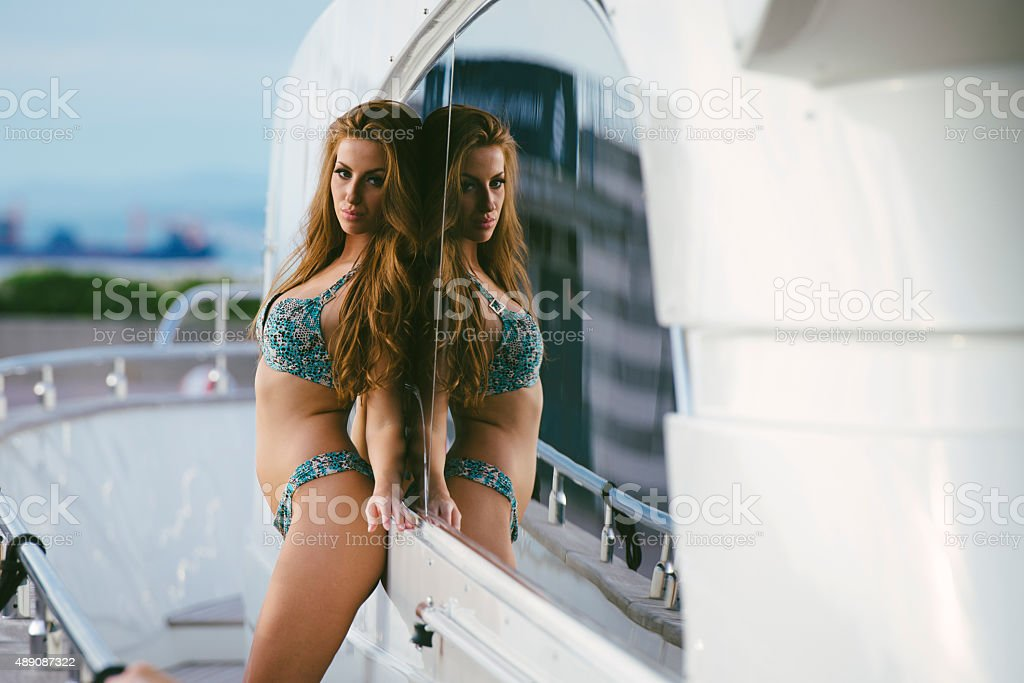 Fashion Model Posing on a Yacht stock photo