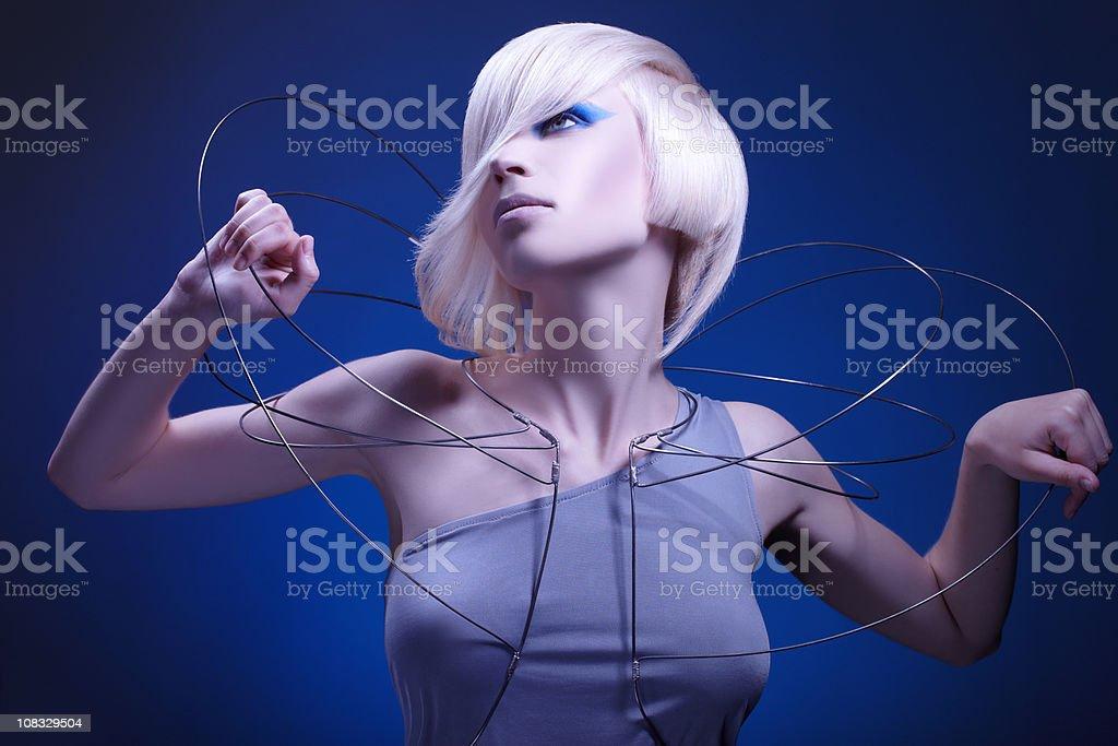 Fashion model posing on blue background royalty-free stock photo