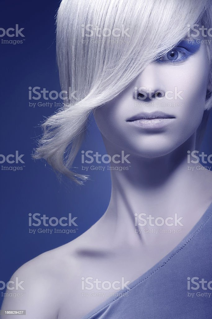 Fashion model posing on blue background royalty-free stock photo