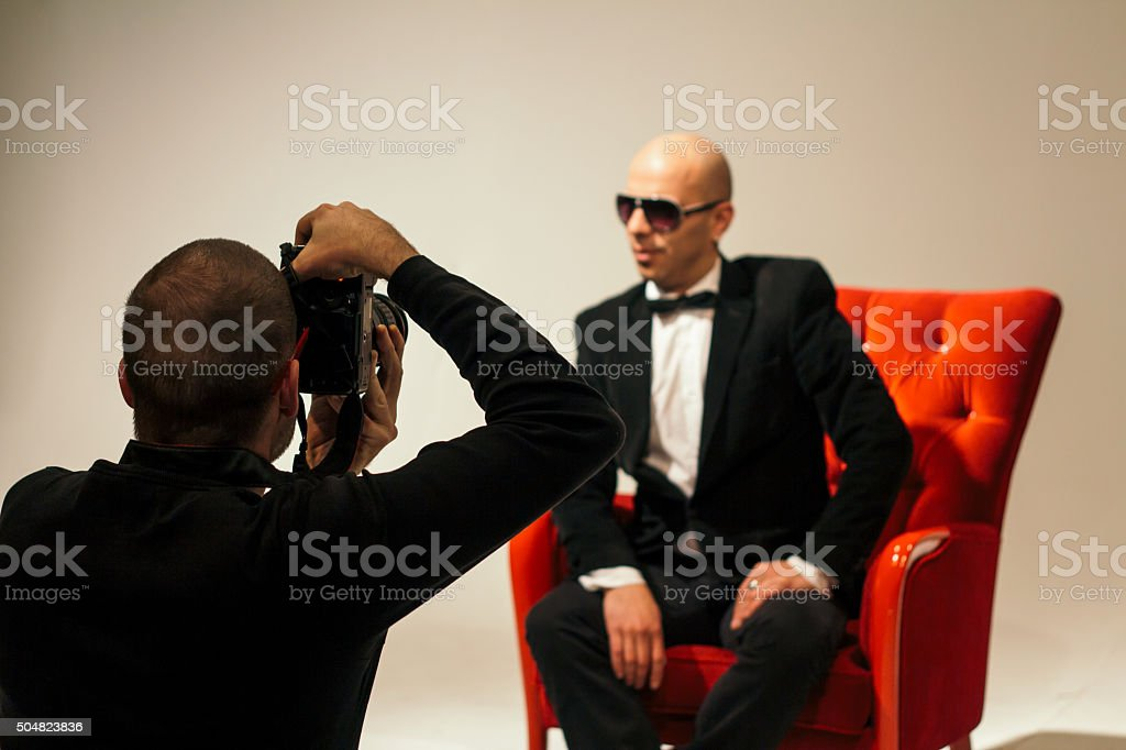 Fashion model posing to the photographer stock photo