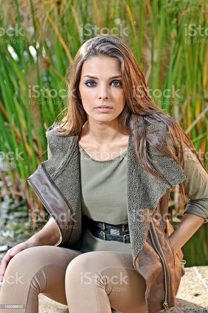Fashion model sitting in a park royalty-free stock photo