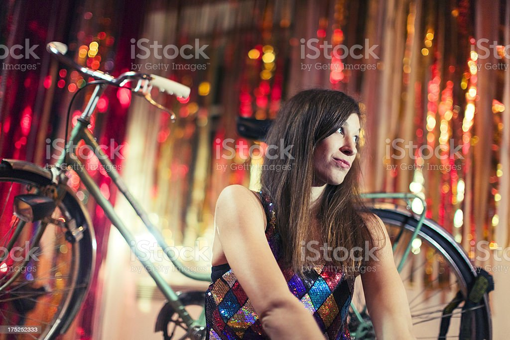 Fashion model sitting in front of bicycle royalty-free stock photo