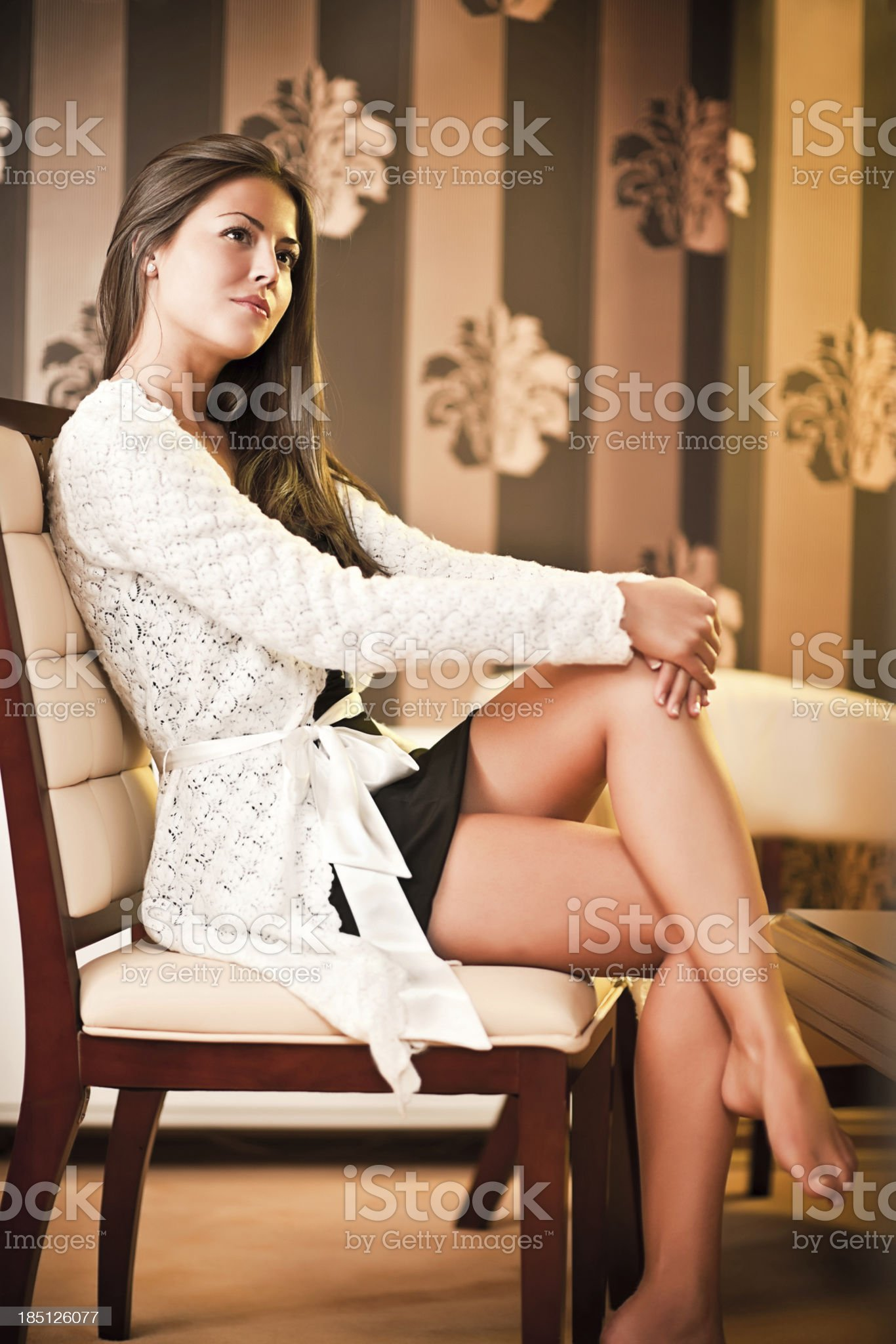 Fashion model sitting on the chair. royalty-free stock photo