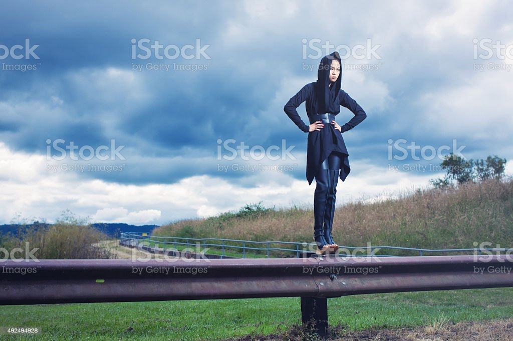 Fashion Model Standing on a Guardrail stock photo