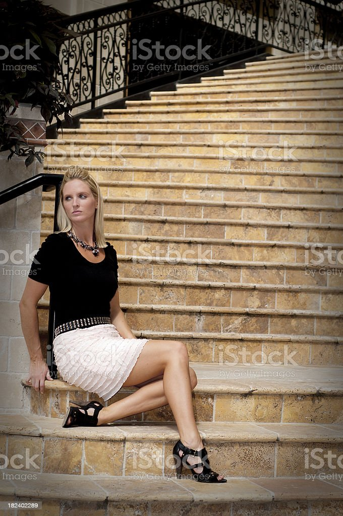 Fashion Model waiting on a staircase royalty-free stock photo