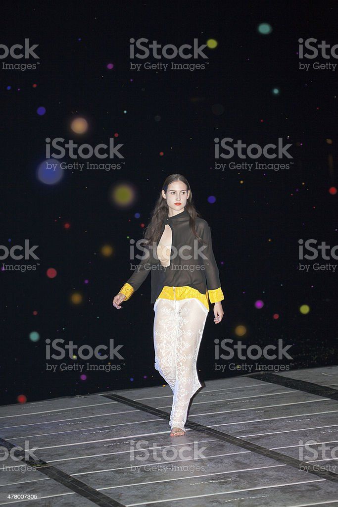 fashion model walking on floating catwalk at night royalty-free stock photo