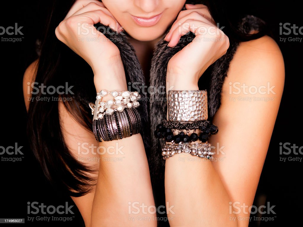 Fashion model wearing bracelets stock photo