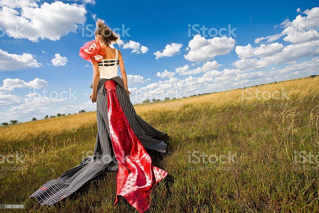 Fashion Model Wearing Dress in Field royalty-free stock photo