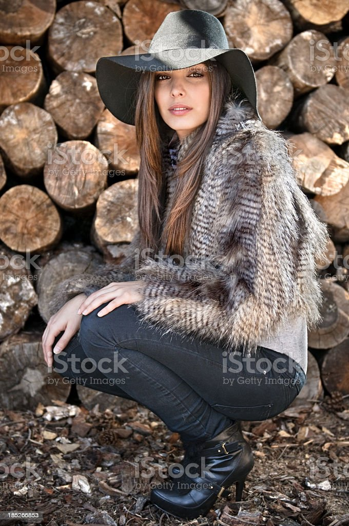 Fashion model wearing furry coat and black pants royalty-free stock photo