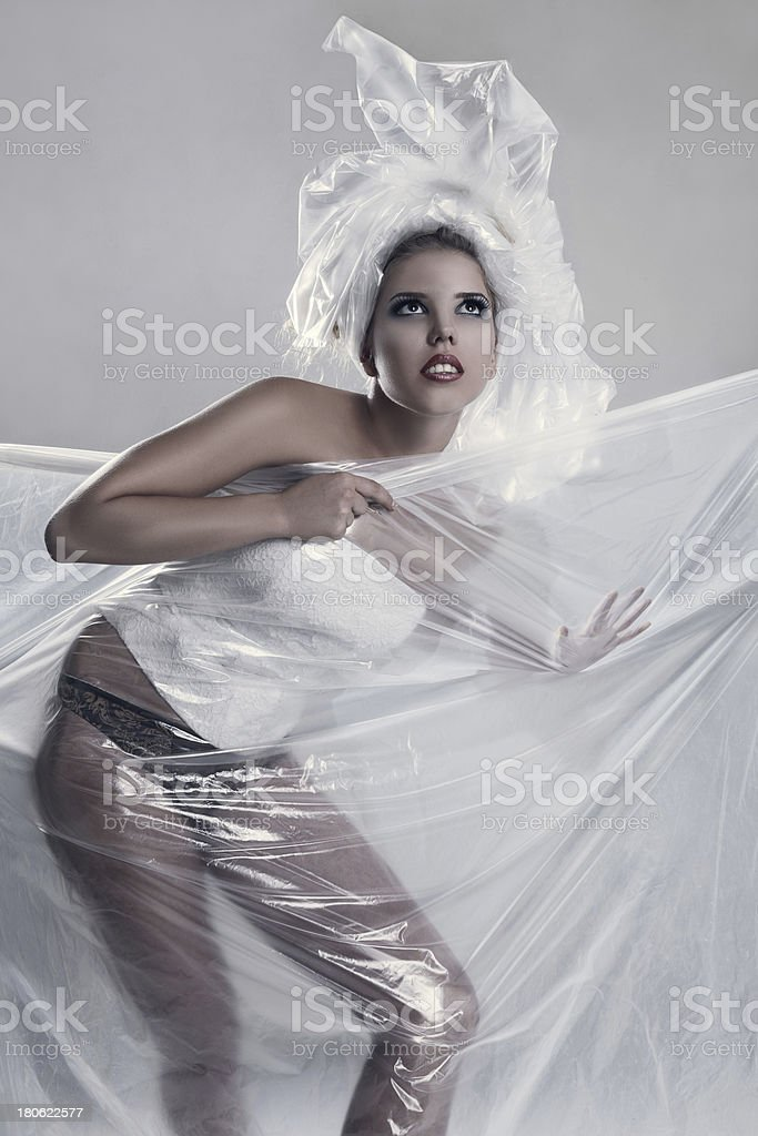 Fashion model wearing in polyethylene dress royalty-free stock photo