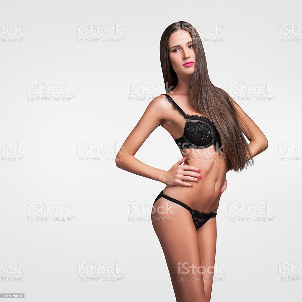fashion model with long hair in black lingerie stock photo