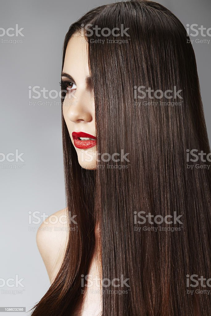 Fashion model with straight long hair and red lips royalty-free stock photo