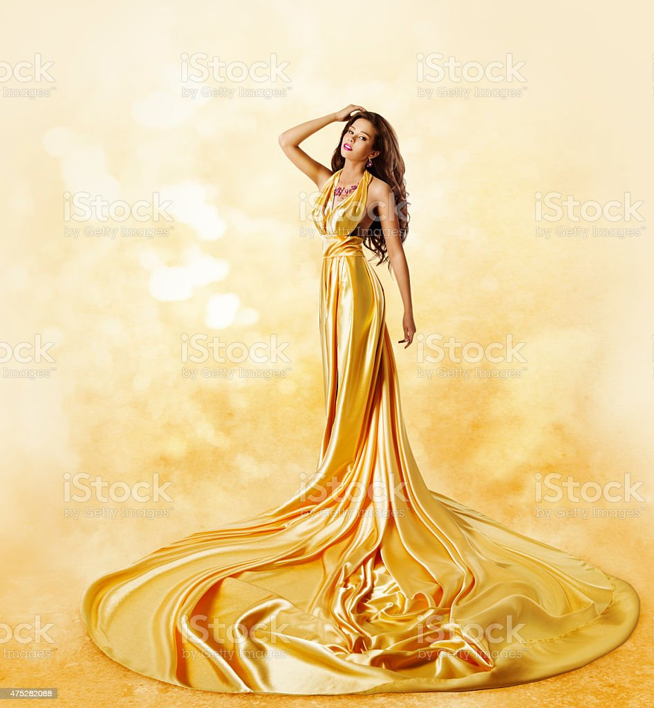 Fashion Model Yellow Dress, Woman Posing Twisted Beauty Gown stock photo