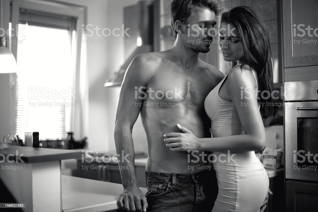 Fashion models in the kitchen royalty-free stock photo
