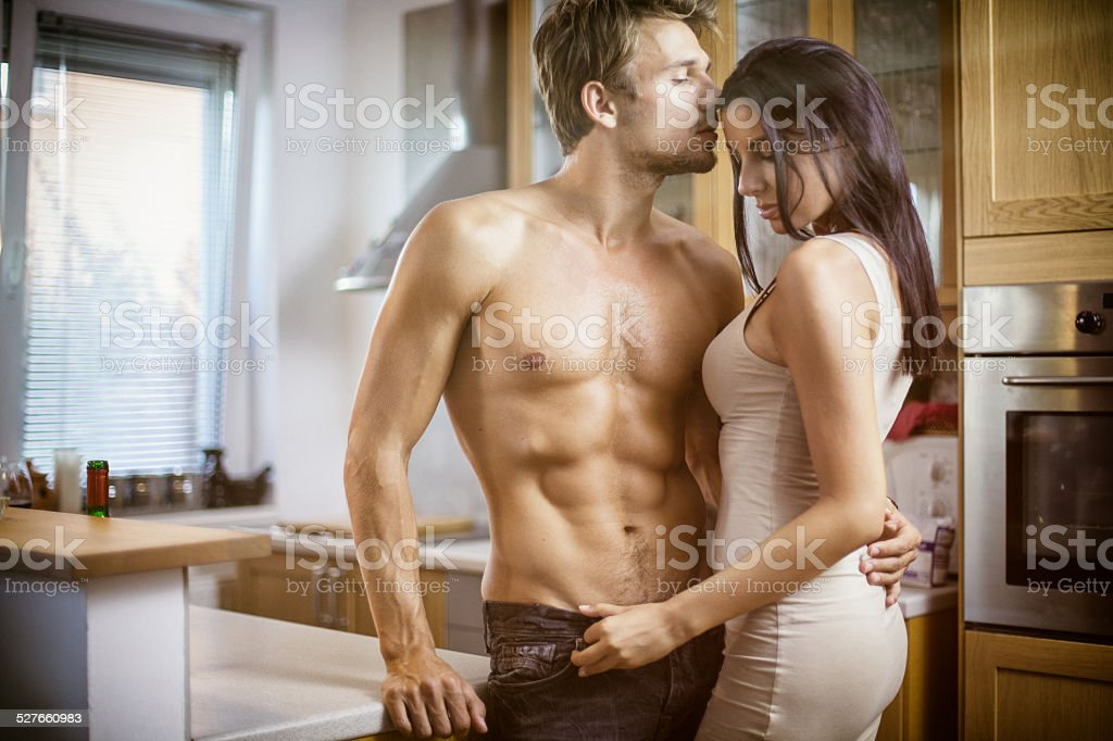 Fashion models in the kitchen stock photo