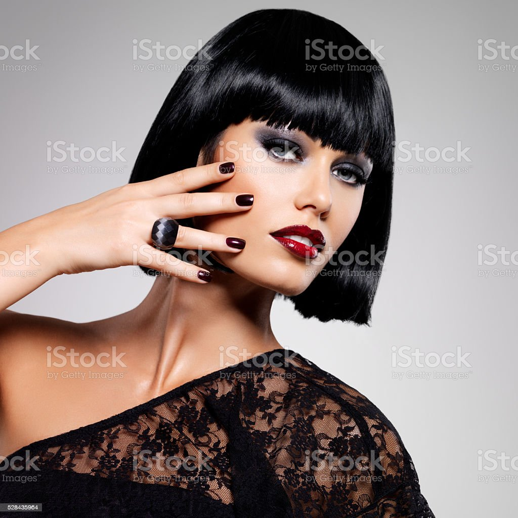 Fashion photo of a beautiful brunette woman with shot hairstyle stock photo
