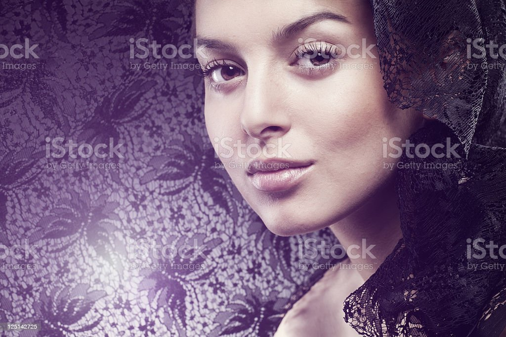 Fashion photo of beautiful woman with black veil. Brightly Lit stock photo
