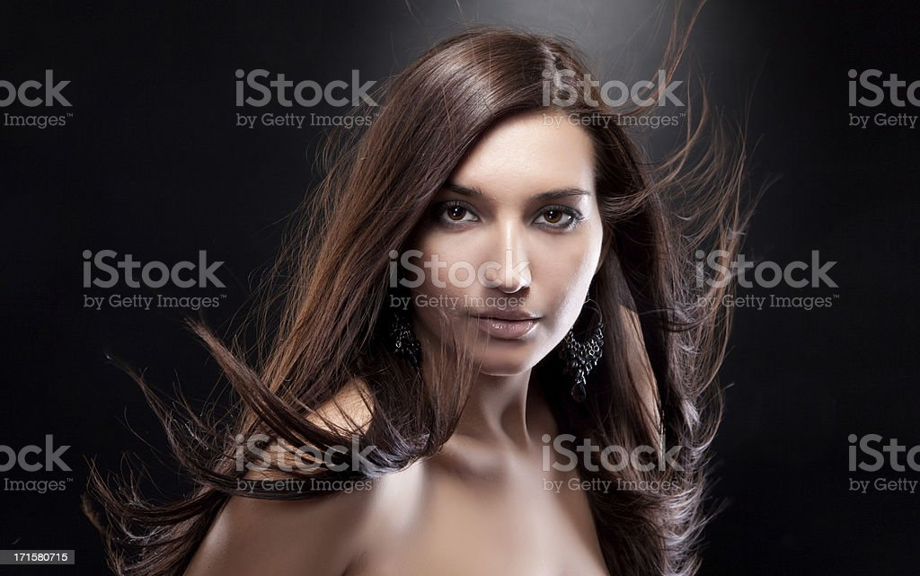 Fashion photo of beautiful woman with magnificent hair royalty-free stock photo