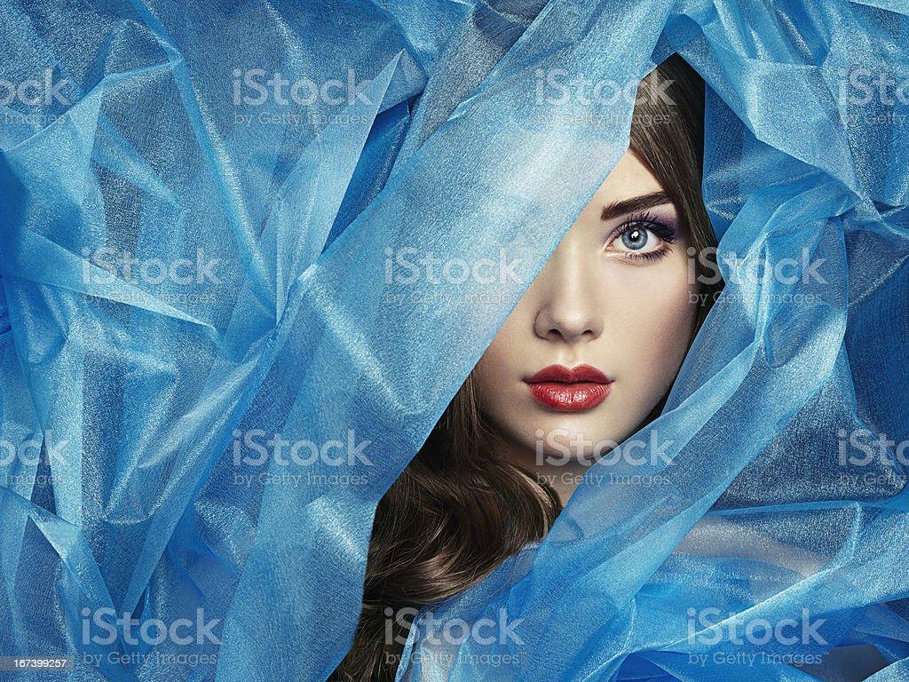 Fashion photo of beautiful women under blue veil stock photo