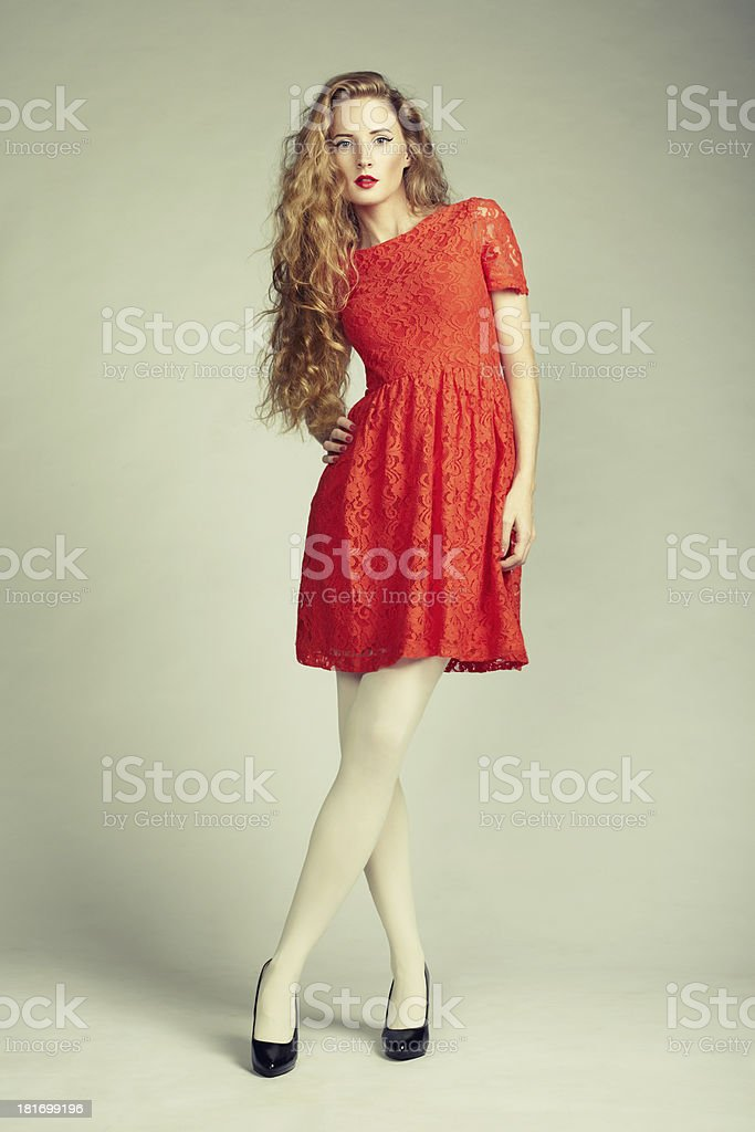 Fashion photo of young magnificent woman in red dress royalty-free stock photo