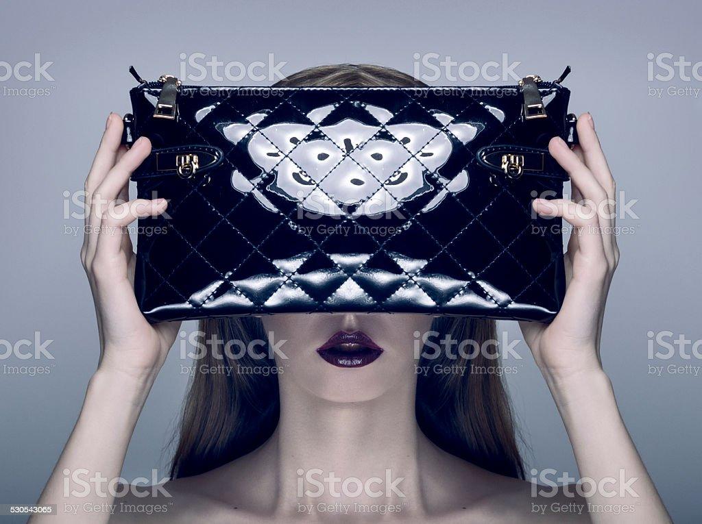 Fashion Photo of Young Pretty Blonde Woman holding a Handbag stock photo