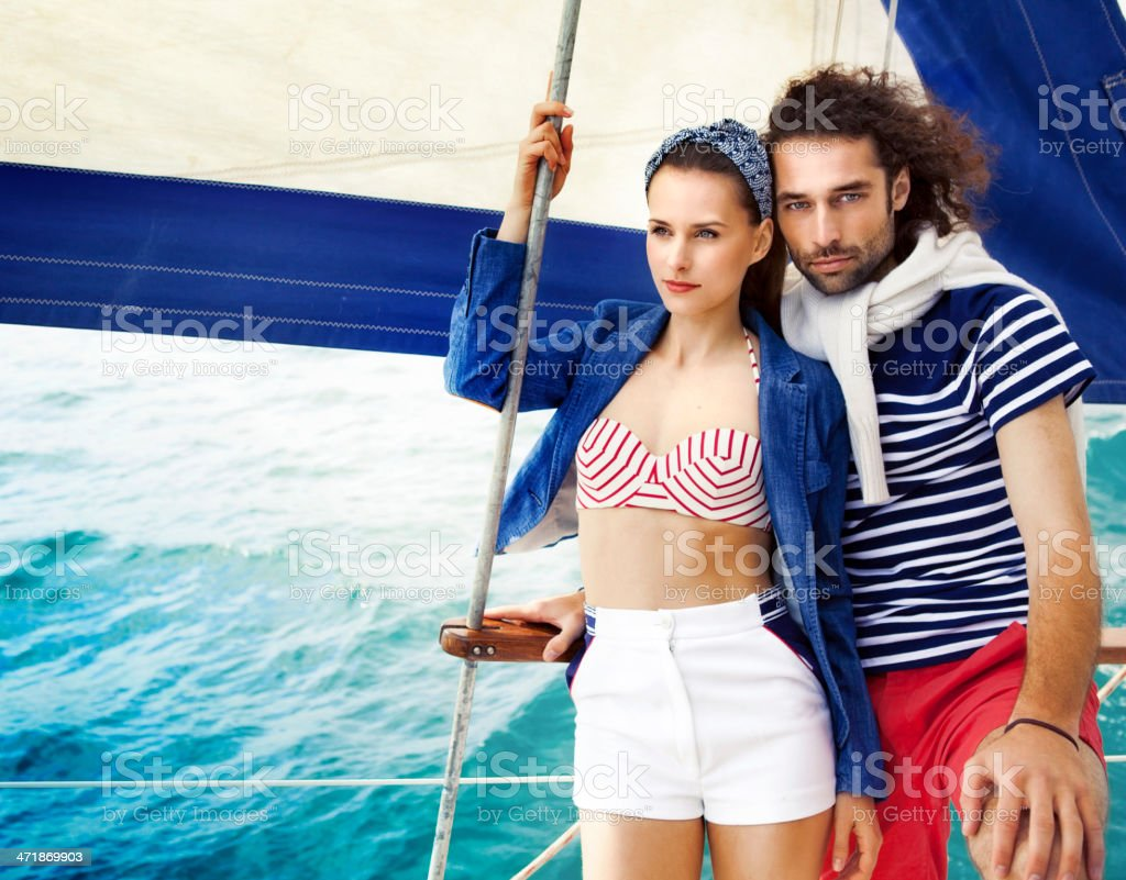 Fashion portrait in a vintage sailing boat royalty-free stock photo