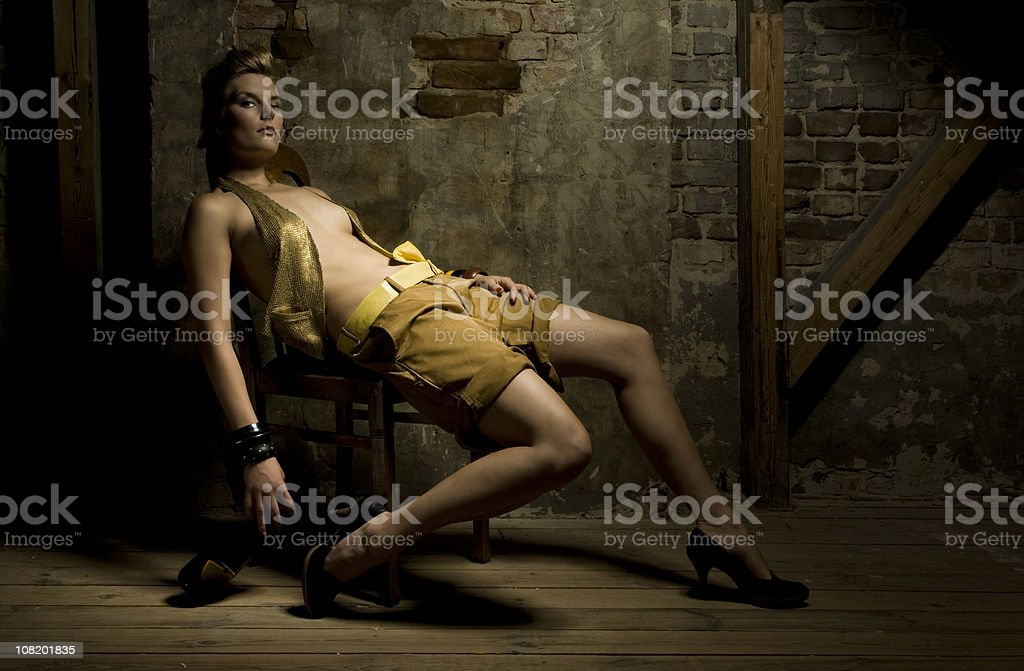 fashion portrait in front of a brick wall stock photo