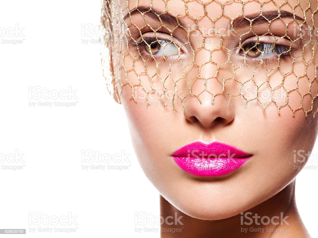 Fashion portrait of a beautiful  girl wears veil on eyes stock photo
