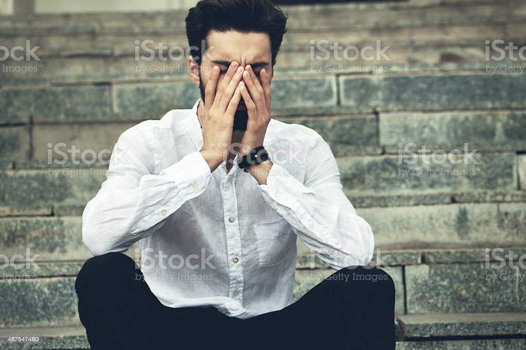 Fashion portrait of a disappointed bearded man. stock photo
