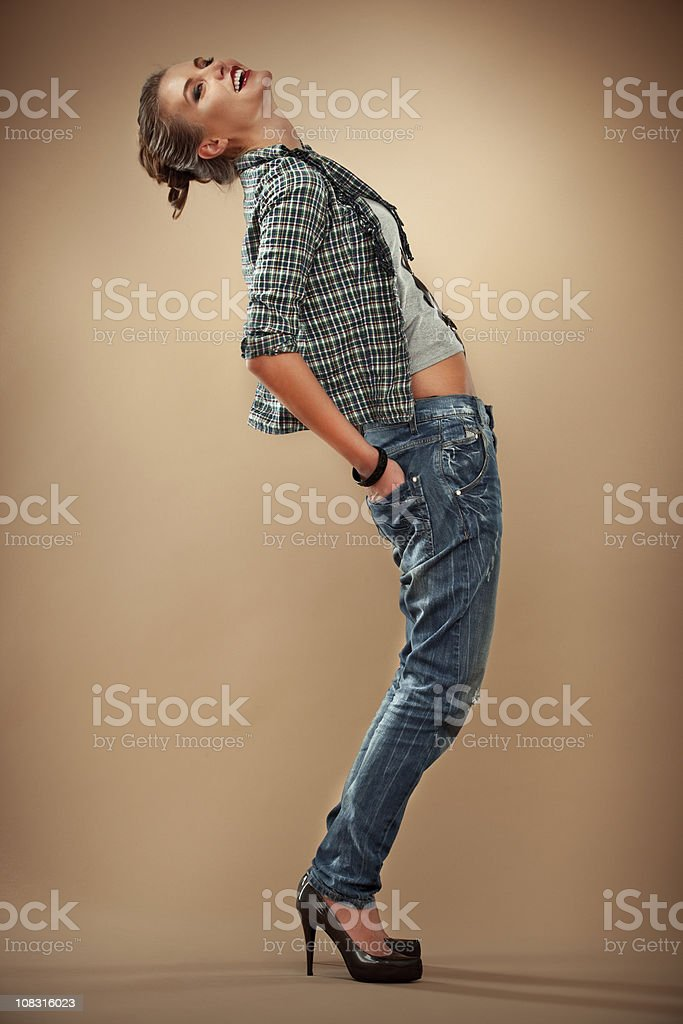 Fashion portrait of beautiful and happy woman on cappuccino background royalty-free stock photo