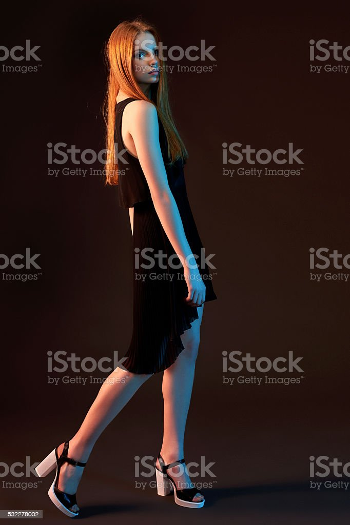 Fashion portrait of beautiful red haired girl stock photo