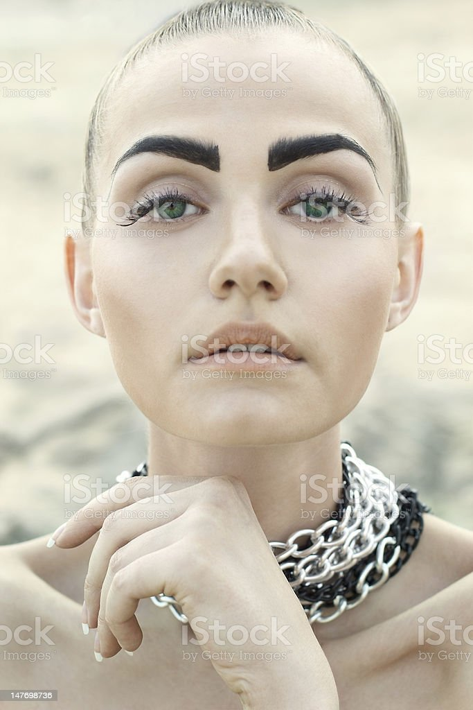 Fashion portrait of beautiful woman with chained neck stock photo
