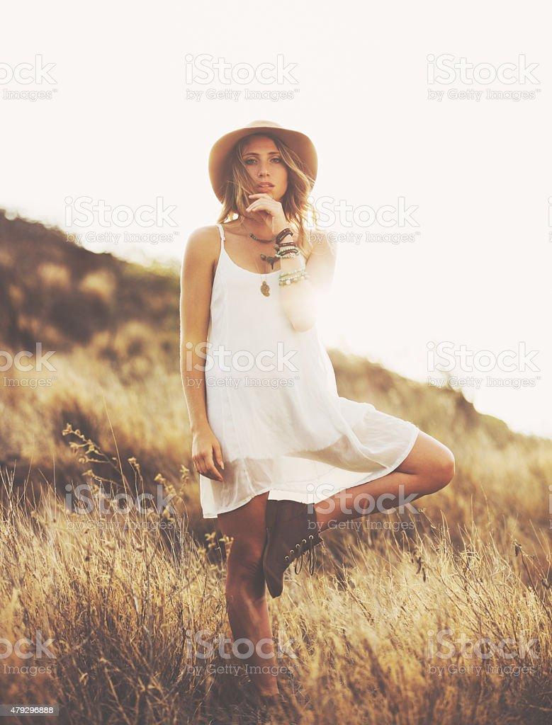 Fashion Portrait of Beautiful Young Woman Backlit at Sunset stock photo