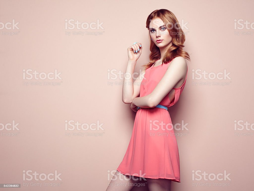 Fashion portrait of beautiful young woman in a summer dress stock photo