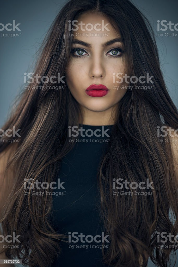 Fashion Portrait of Beautiful Young Woman with Long Hair stock photo