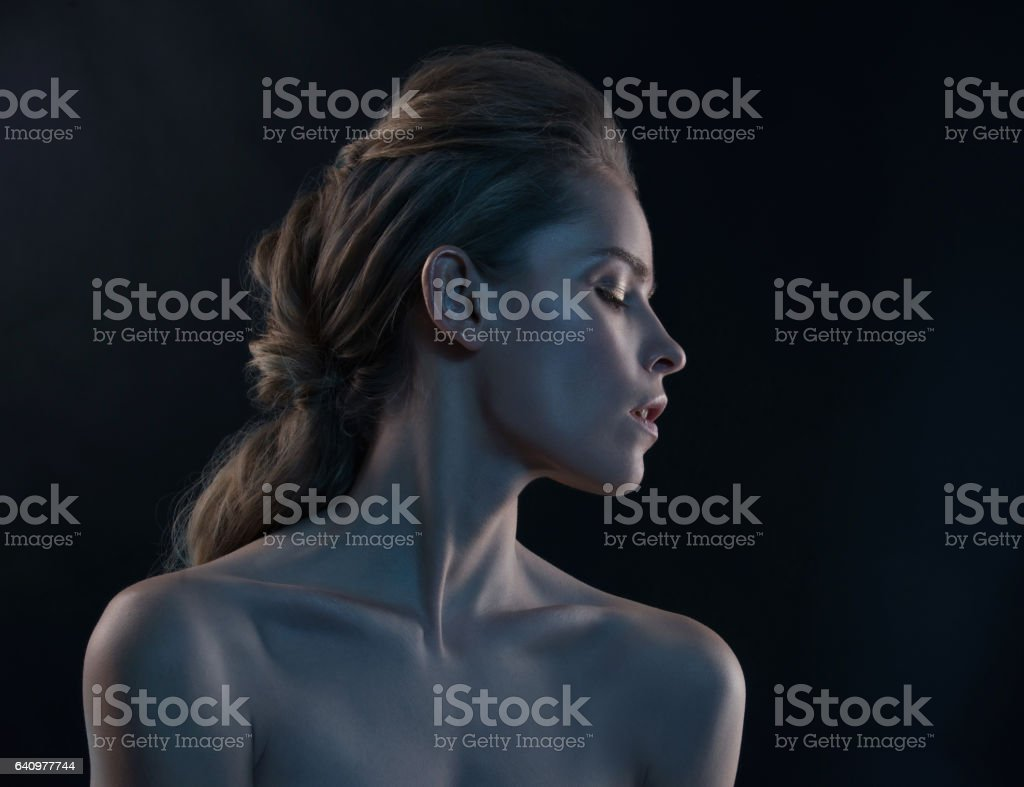 Fashion portrait of model in the light colored spotlights. stock photo