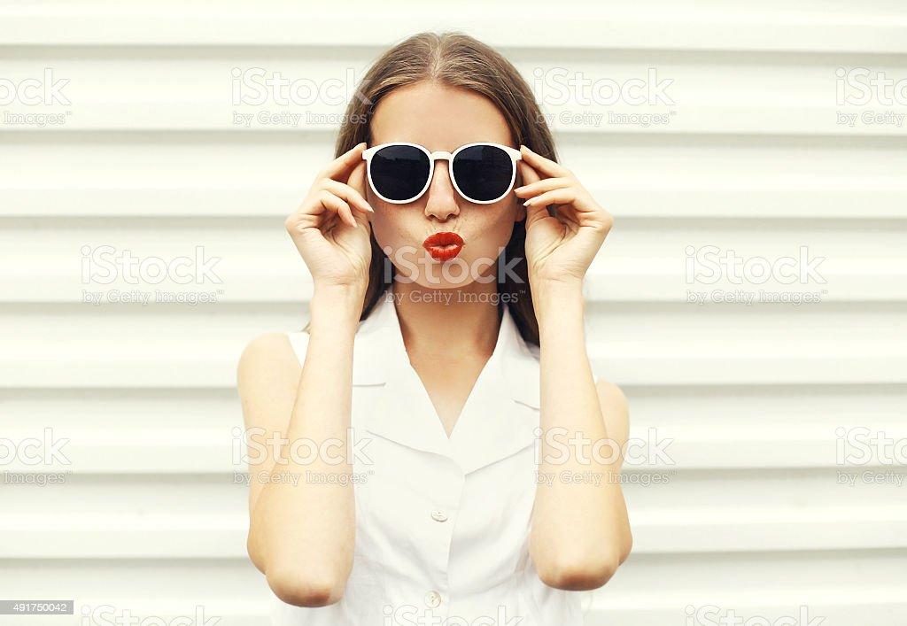 Fashion portrait of pretty young woman in white sunglasses stock photo