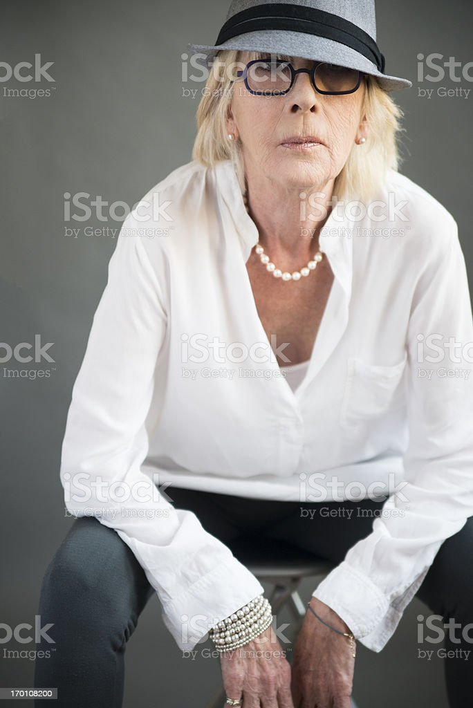 Fashion portrait of real woman in her seventies. royalty-free stock photo