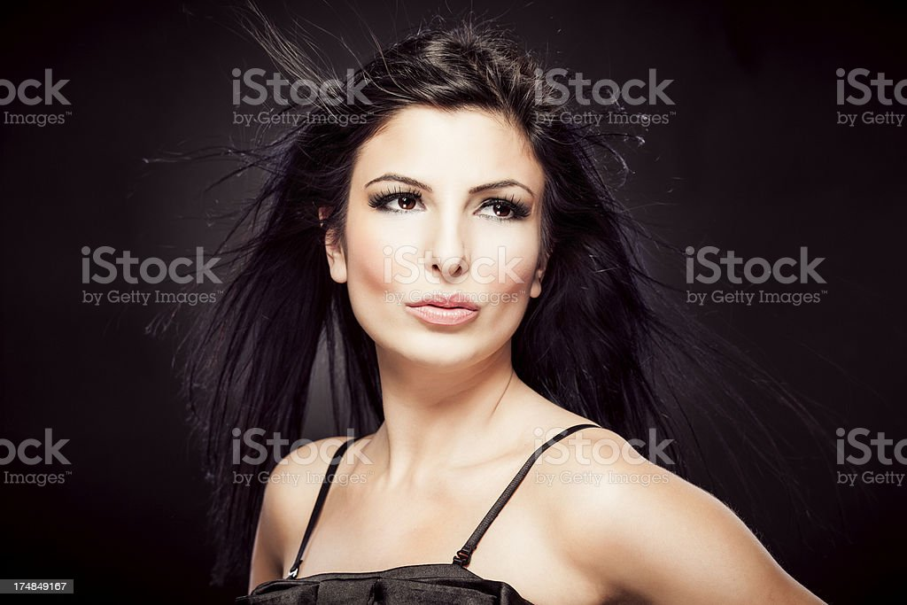 Fashion portrait of sensual young woman on dark background royalty-free stock photo