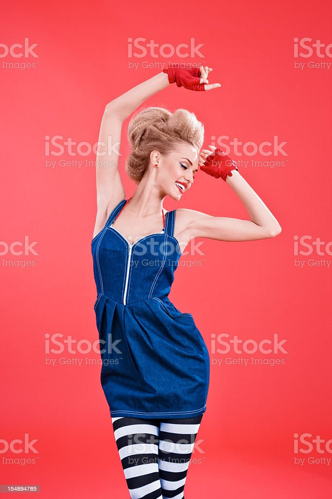 Fashion portrait of woman dancing against red background royalty-free stock photo