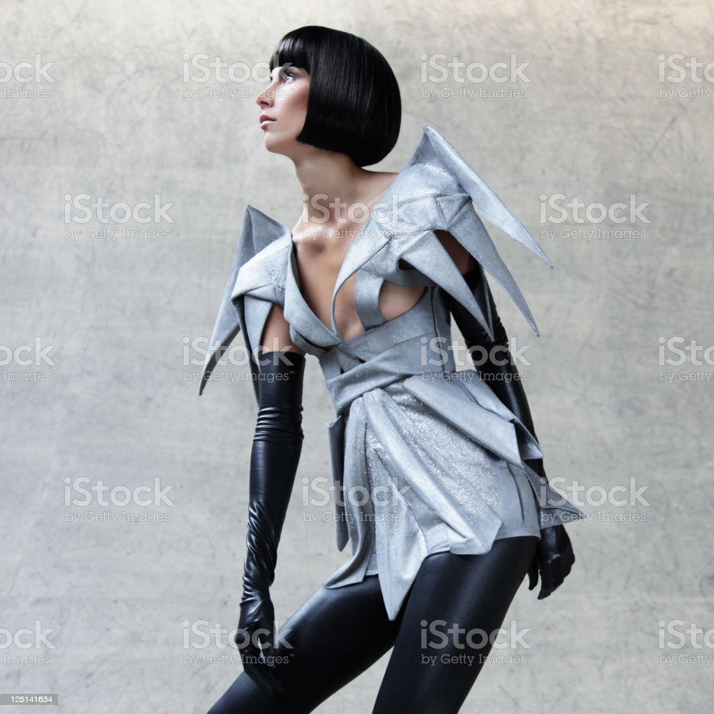 Fashion portrait of woman in futuristic clothes stock photo
