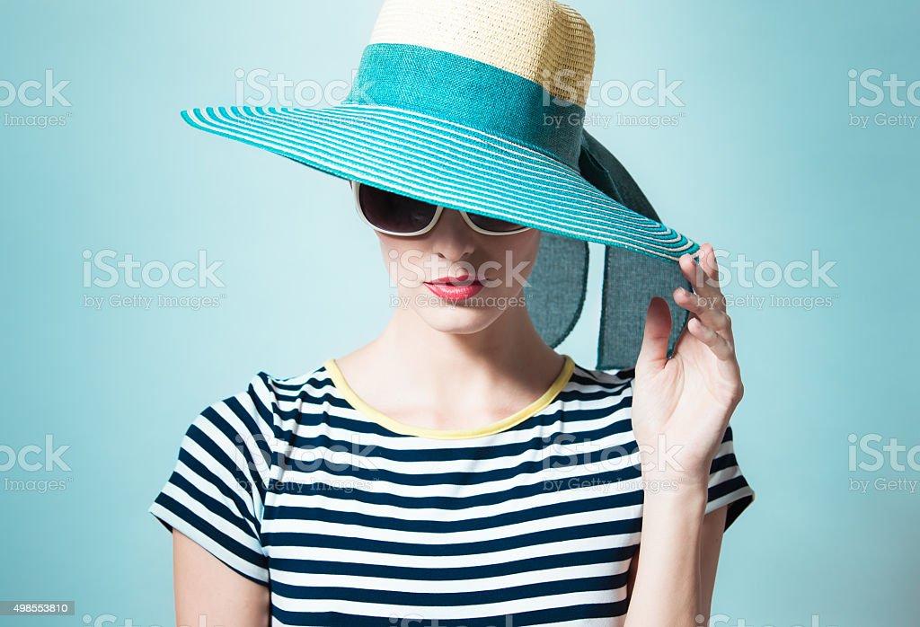 Fashion portrait of woman wearing hat stock photo