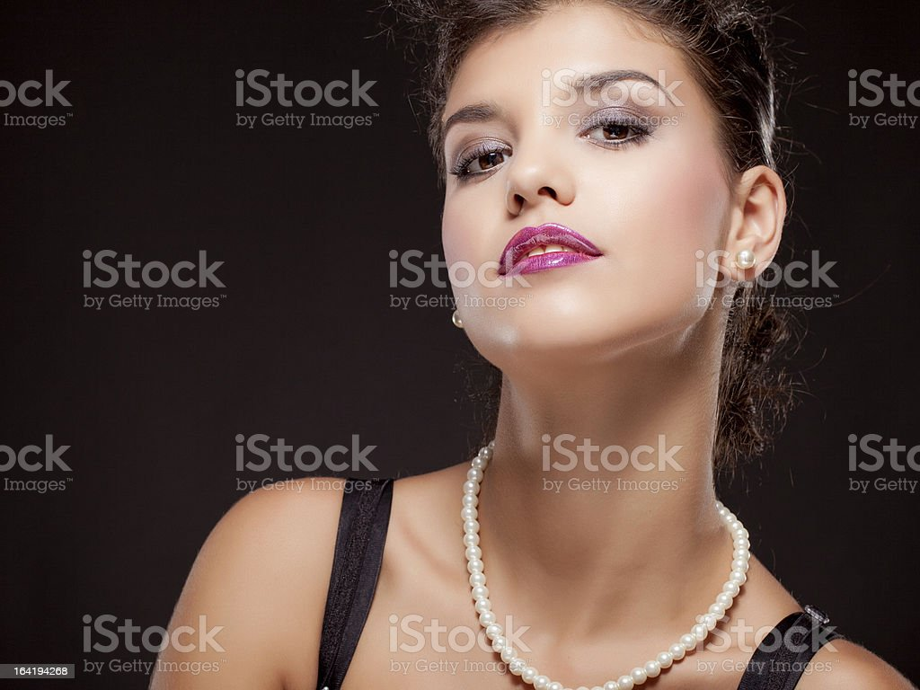 Fashion portrait of young beautiful woman in the black dress stock photo